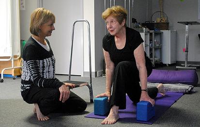 Bev Stegman with yoga client