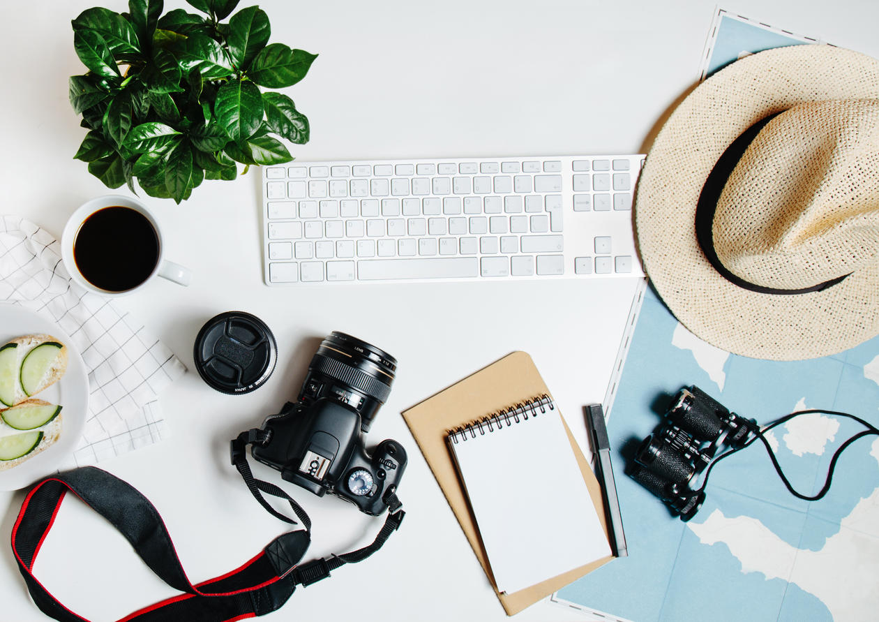 Beautiful hipster flatlay with hat, dslr