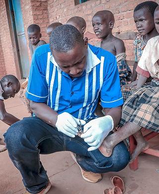 2-Burundi Ben treating kid.jpeg