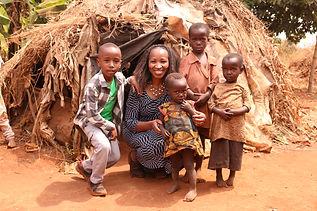 Rutoke family-helping build them a house.JPG