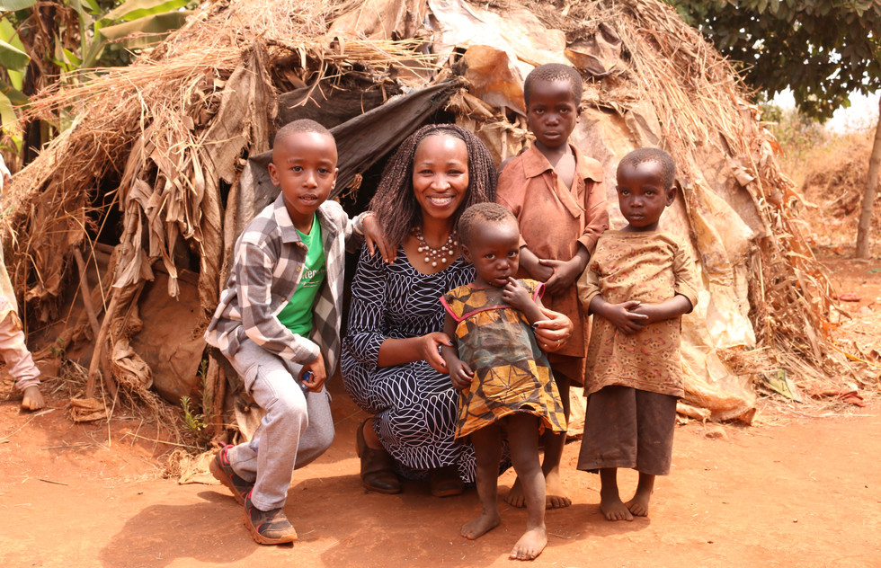 Copy of Rutoke family-helping build them a house.JPG