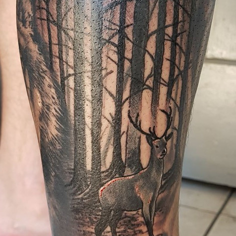 Deer in forest tattoo