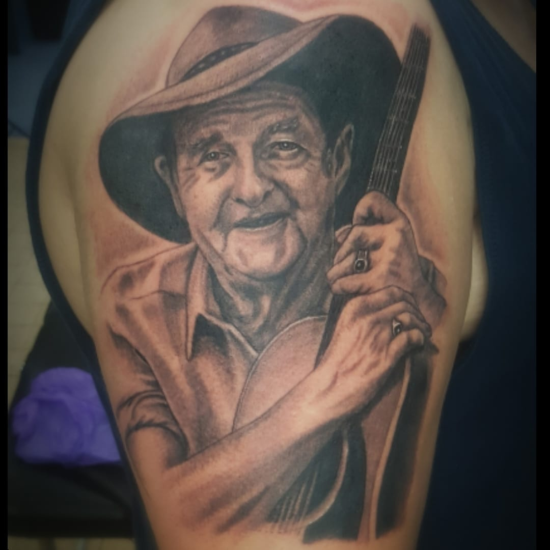 Slim Dusty tattoo