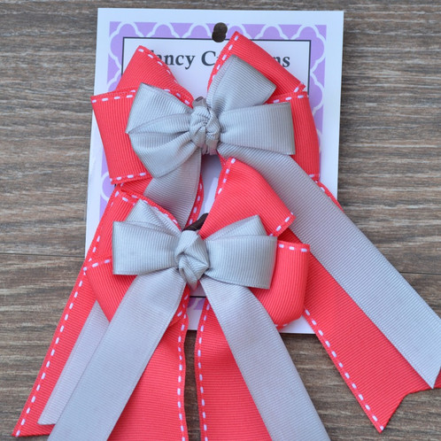 2c18f660b891 All of our bows are made with high quality ribbon and are durable. They are  held together with a rosette tie, and a brown elastic on the back.