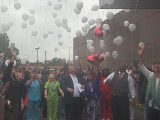 A Balloon Release to Honor a Local Educator who was killed in her home