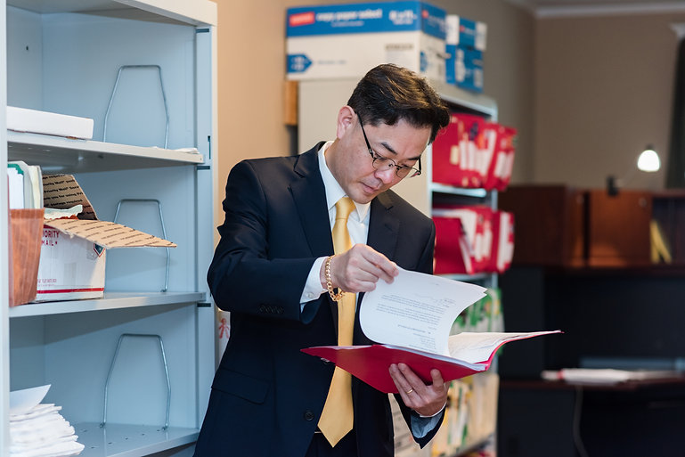 Chan Reviewing Documents.jpg