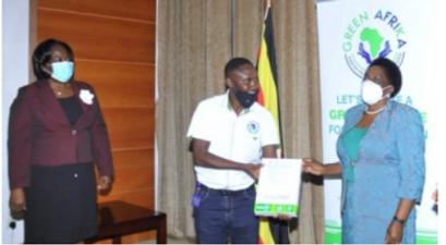 delivering envoPaP paper to Ugandan ministry