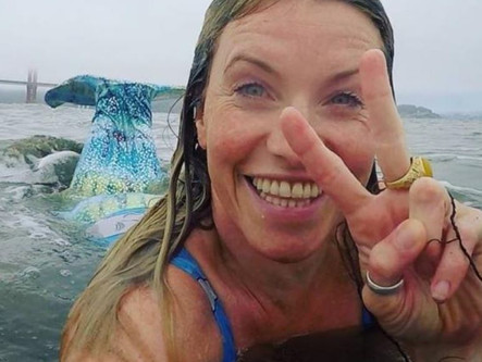 Mermaid swims for plastic