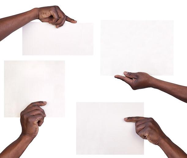 black hand holding paper