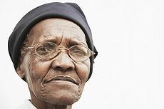 Closeup portrait of elderly woman wearin