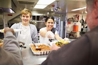 Staff Serving Food In Homeless Shelter K