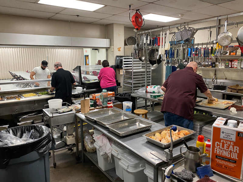 Staff and Volunteers hard at work in the kitchen