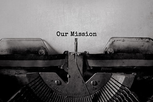 Our Mission typed words on a Vintage Typ