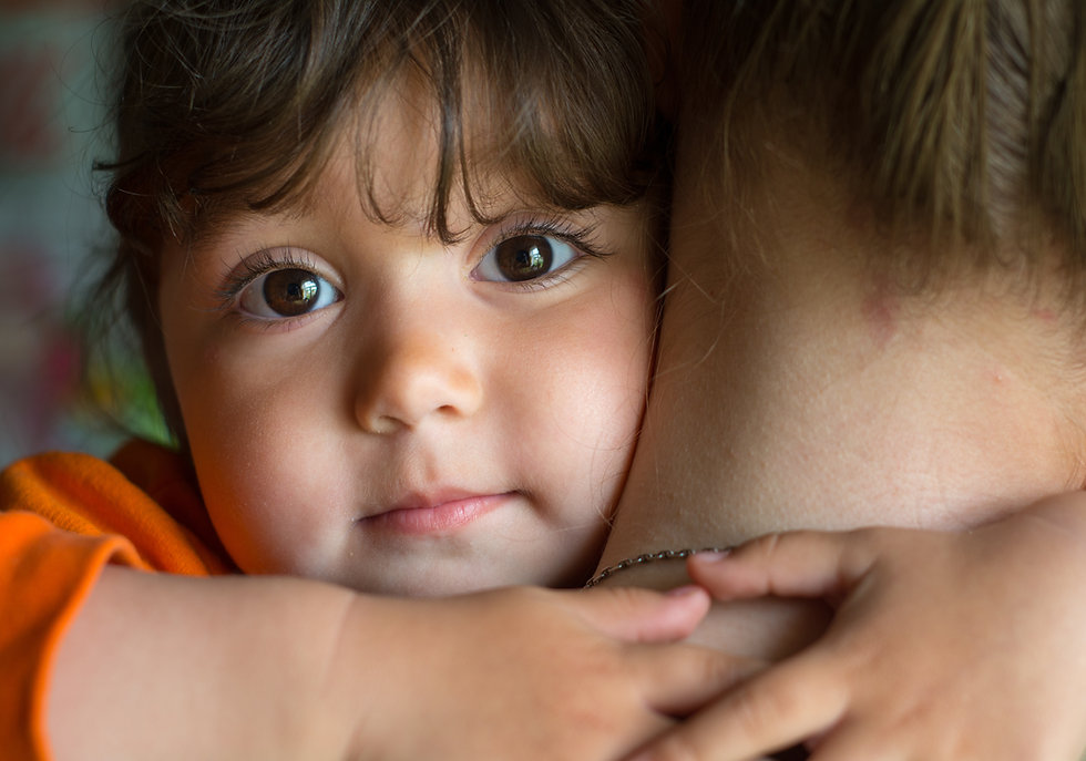Child girl with both hands hugging his m