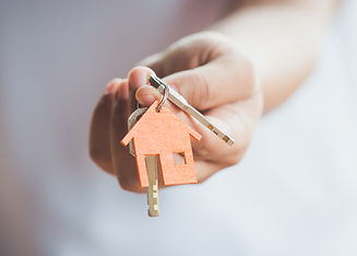 Female hand holding house key,real estat