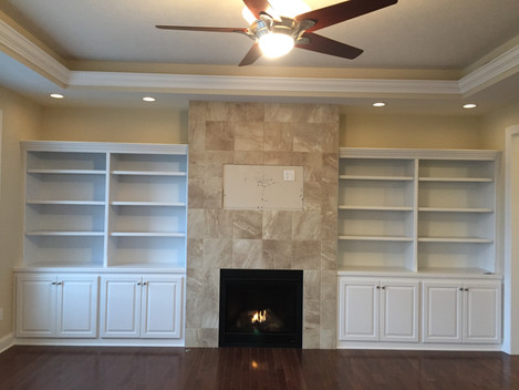 Gorgeous Great Room with Custom Built-In Cabinetry, Floor to Ceiling Fireplace Surround, Step Ceiling with Crown Molding and Enhanced Lighting