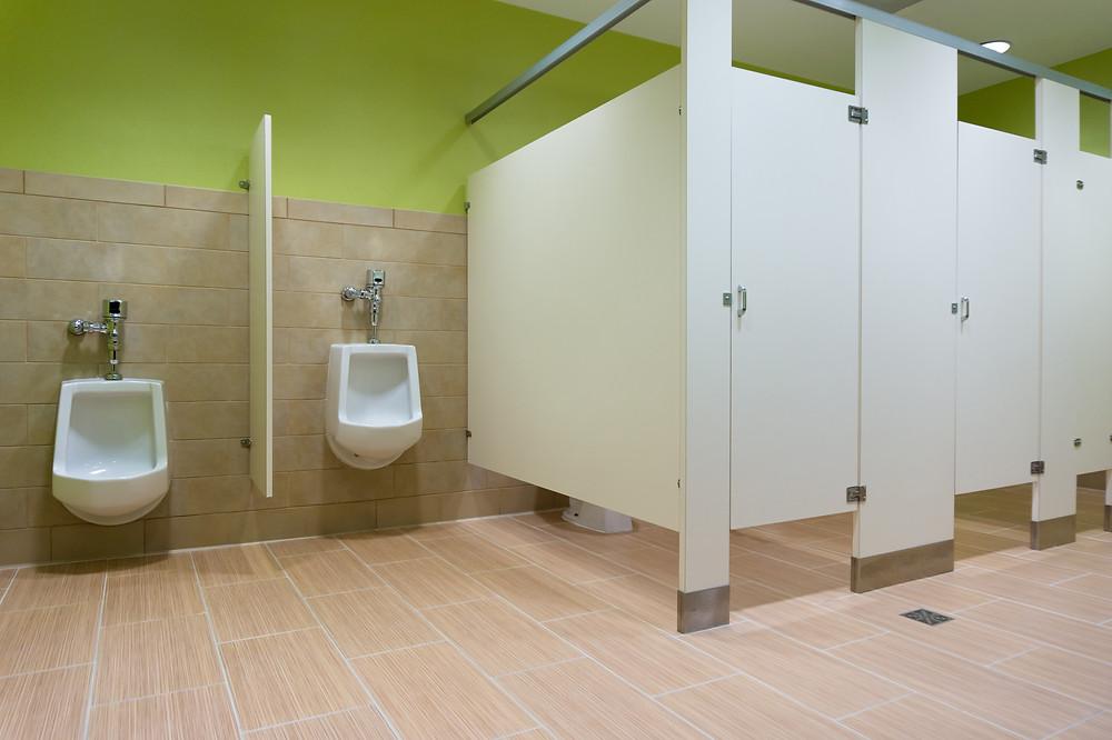 Men's restroom with stalls and urinals