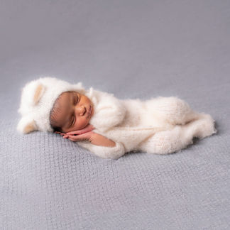 Baby sleeping in mohair outfit