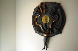 Skull / snake clock by Malin Isaksson.