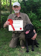 Malcolm Livesley with Dusk, winners of the Novice Retriever class at Arvie