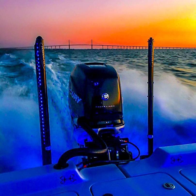 bass boat motor on lake