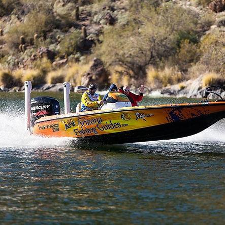 Arizona fishing guides on lake in bass boat