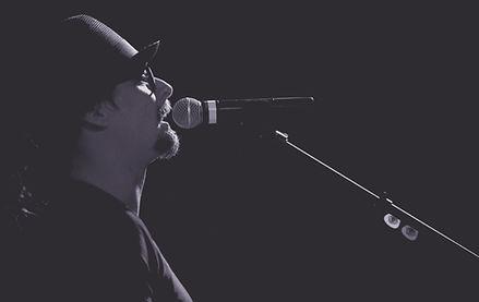 Singer Wearing Hat