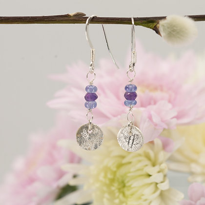 Earrings: Tanzanite and amethyst with hand made fine silver discs