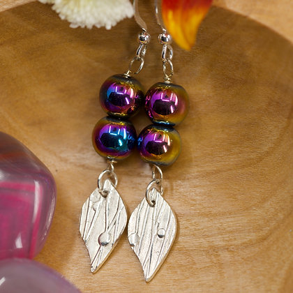 Rainbow  haematite with fine silver charms