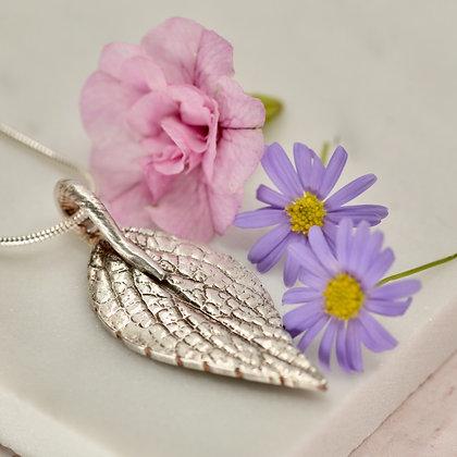 Silver pendant: Polyanthus leaf with patterned back