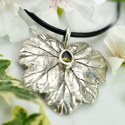 Large fine silver Geranium leaf with lab-created peridot