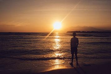 negative-space-man-beach-sunset-mountains-bucketlistly.jpg