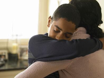 Mother giving a hug
