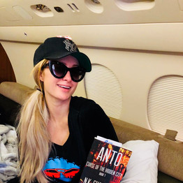 Paris Hilton posing with Anto book