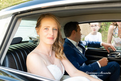 Pretty bride in a car