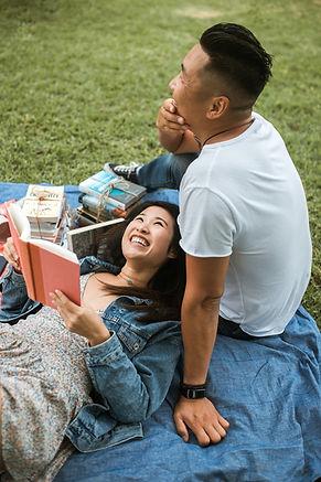couple reading on picnic blanket.jpg