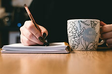 writing with coffee cup.jpg