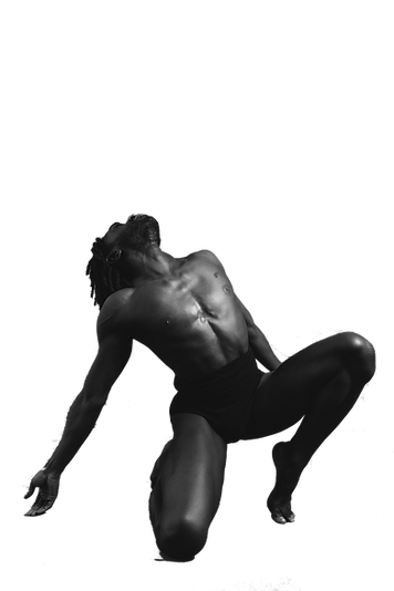 Chalvar Monteiro, in black and white, kneels while looking up toward the ceiling with his whole upper body.