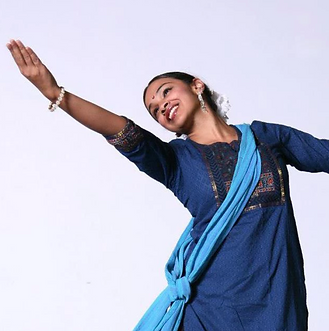 """Brinda performs with a smile on her face at """"NYC Dance Week"""" at Dixon Place."""