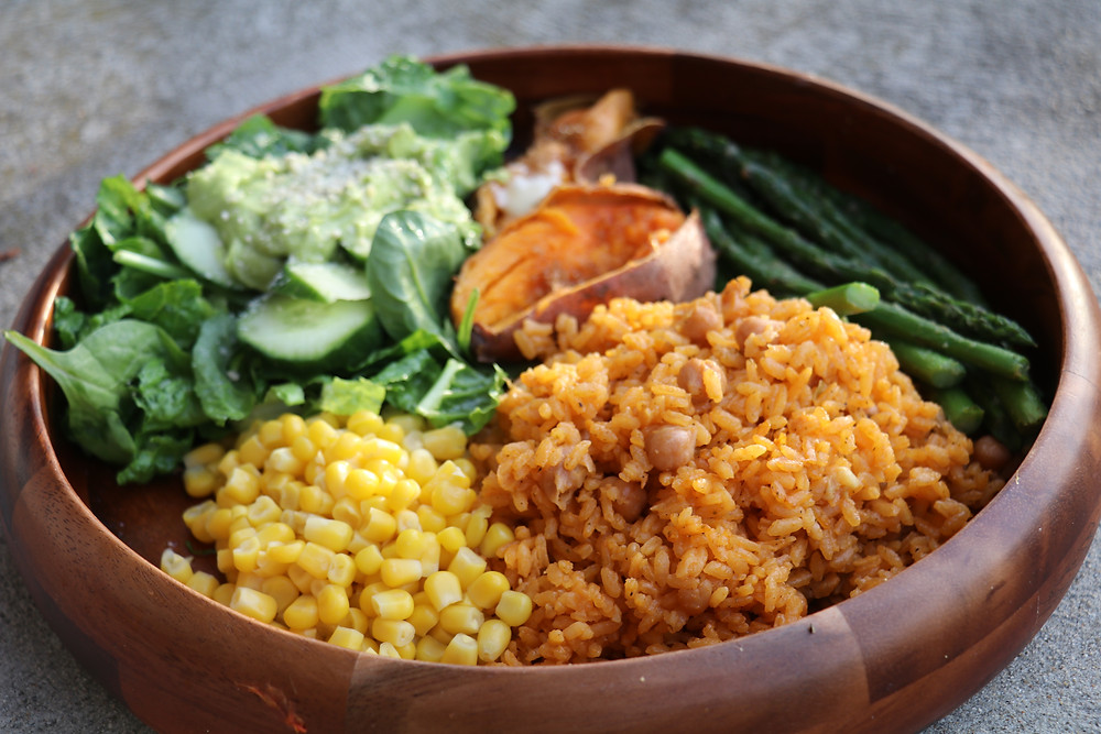 Yellow rice and garbanzo beans, steamed corn, fresh avocado salad, grilled asparagus, and baked maple sweet potates