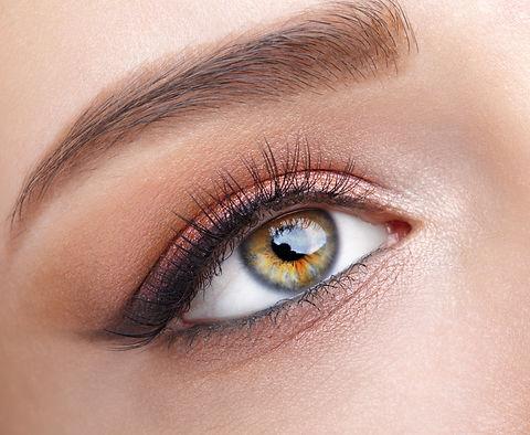 Closeup macro shot of  human female eye. Woman with natural evening vogue eye beauty makeu
