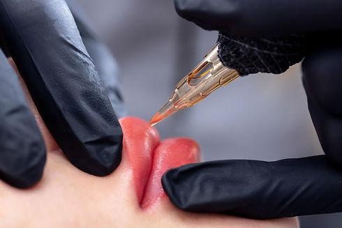 Process woman applying permanent tattoo