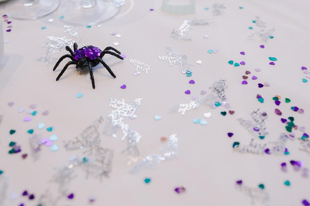 Glitter spider and table confetti