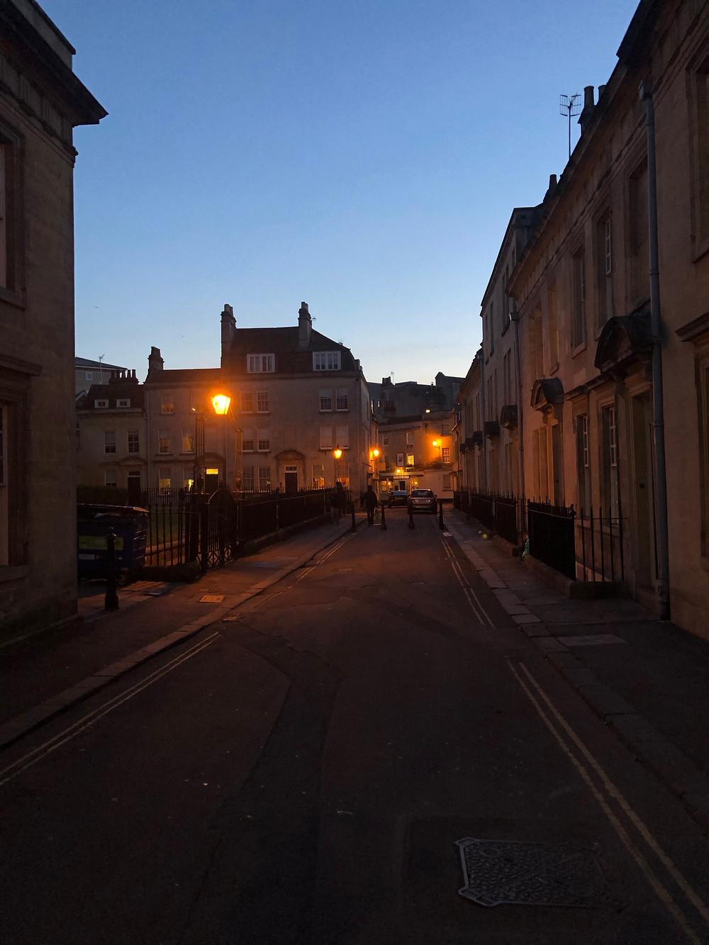 Night photo of a street in Bath.