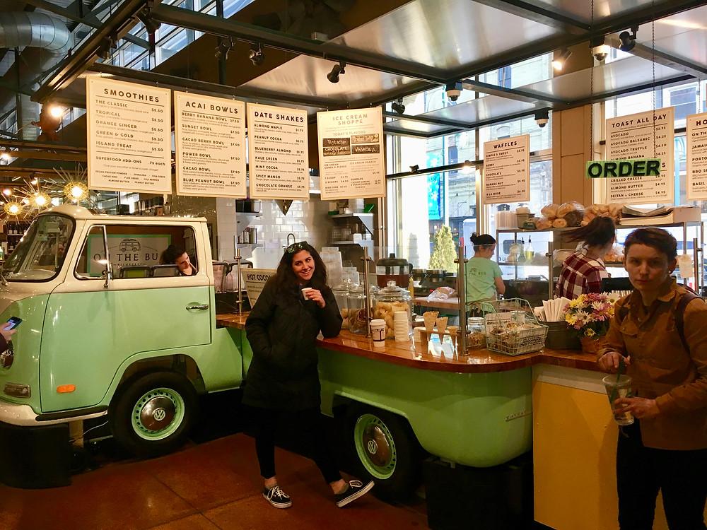 My sister ordering juice inside Milwaukee Public Market