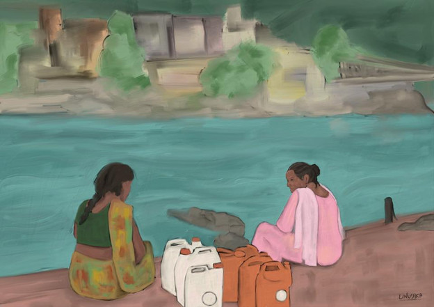 Two women talking on the river bank.