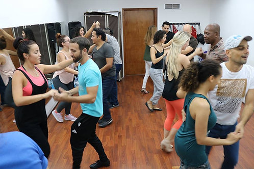 One Salsa or Bachata group lesson