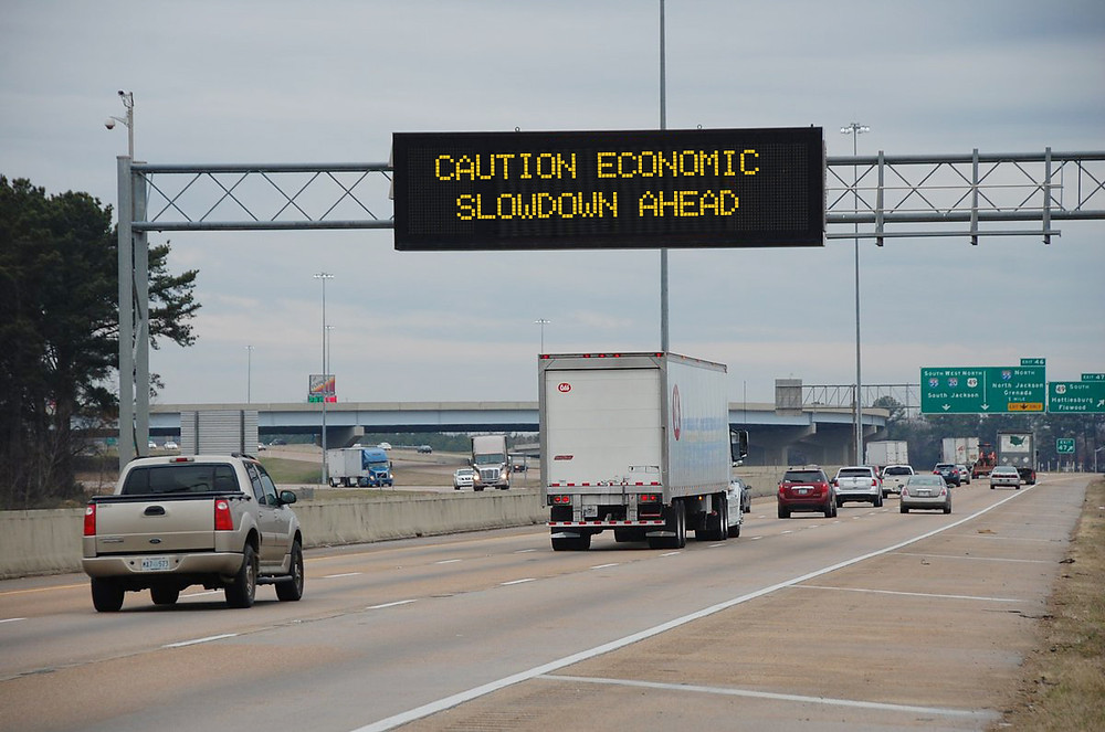 SLOWDOWN: Mississippi's poor economic performance might explain why 60,000 people have left the state in recent years. Photo illustration by Steve Wilson