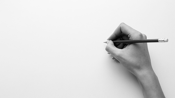 top-view-hand-holding-pencil-with-copy-space (1).png
