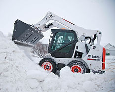 Bobcat Skid Steer removing snow Joplin